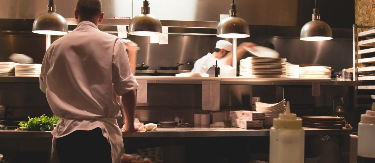 men cooking in a kitchen of a restaurant