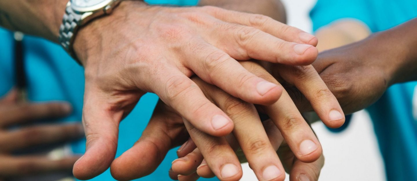Hands joining to help