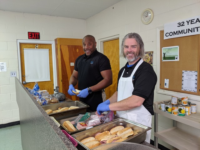 OTRS employees help at Dorothy Day Soup Kitchen with making sandwiches
