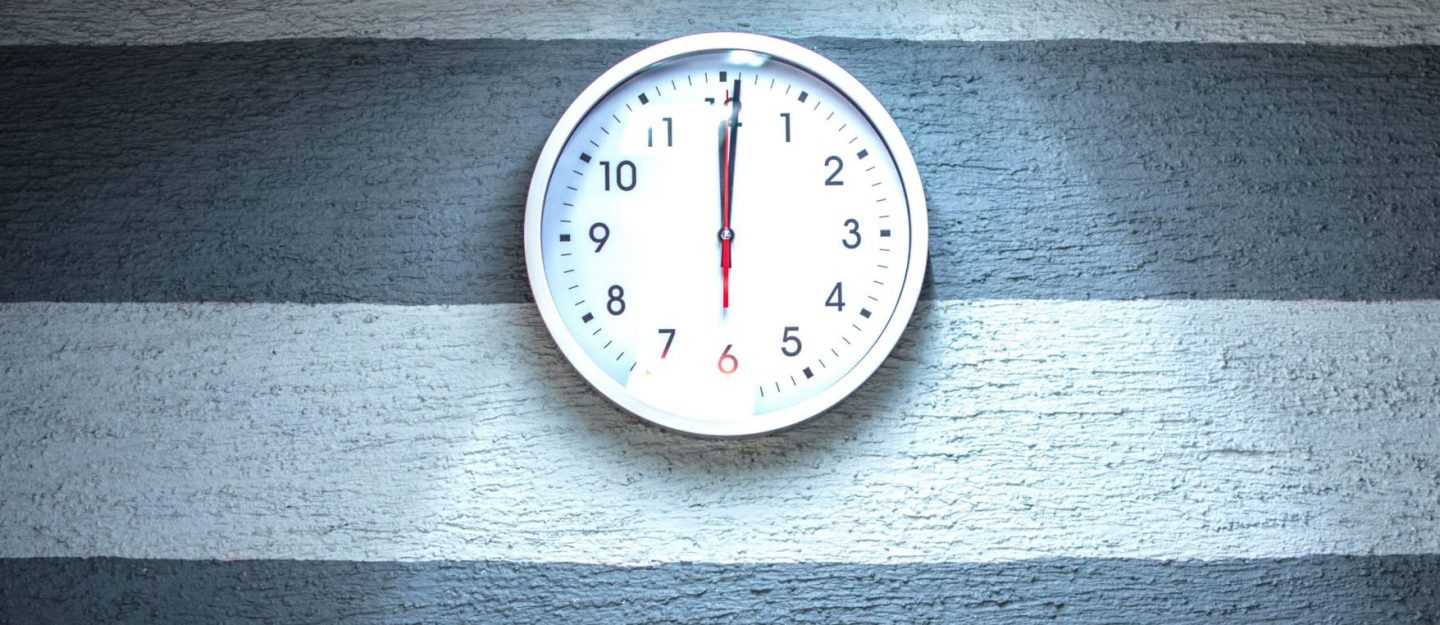 clock on a grey wall