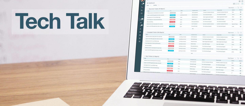Laptop shows OTRS screen on a desk with headline tech talk