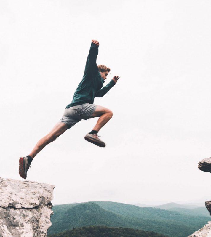 man-jumps-over-a-gap