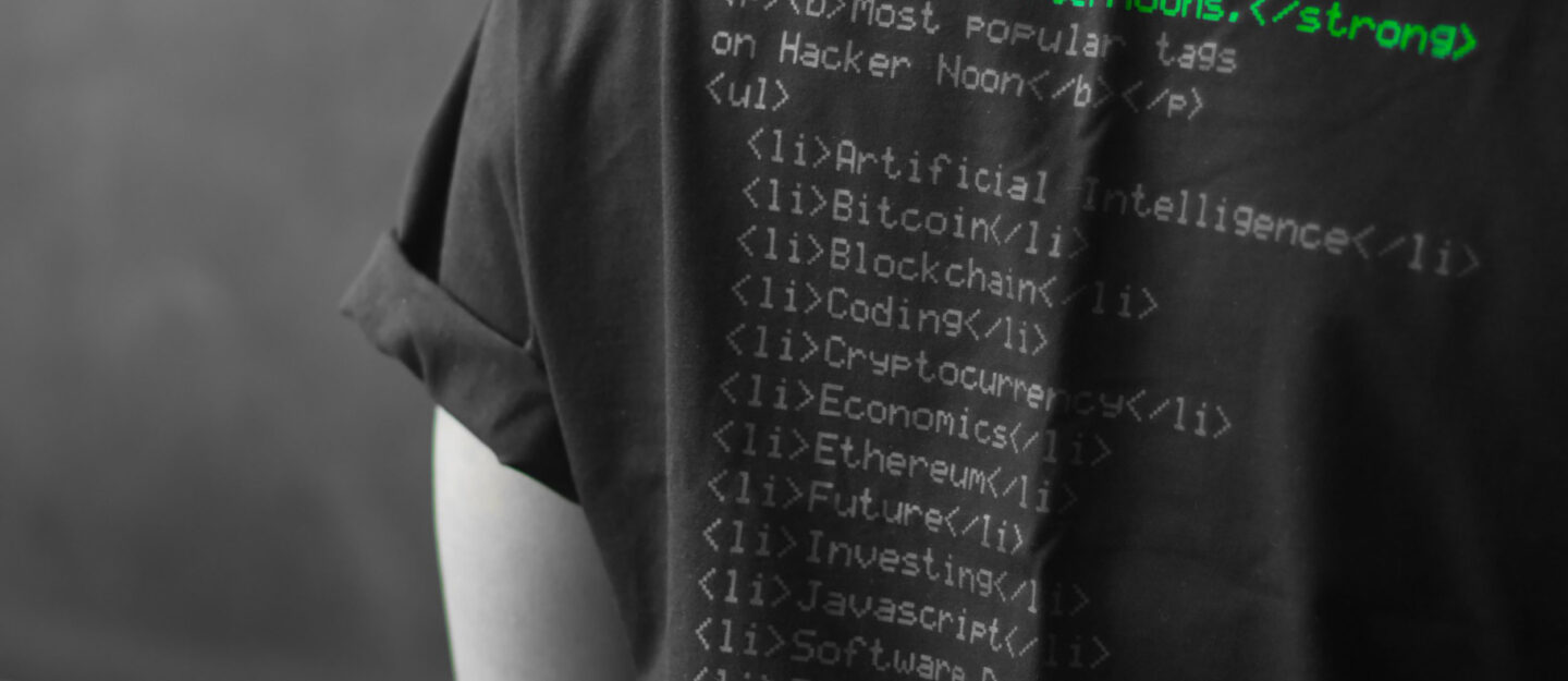 man wearing shirt with code on the back