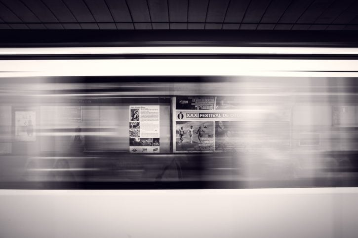 Ads visible through windows of a speeding train
