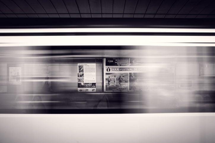 Ads visible through windows of a speeding train