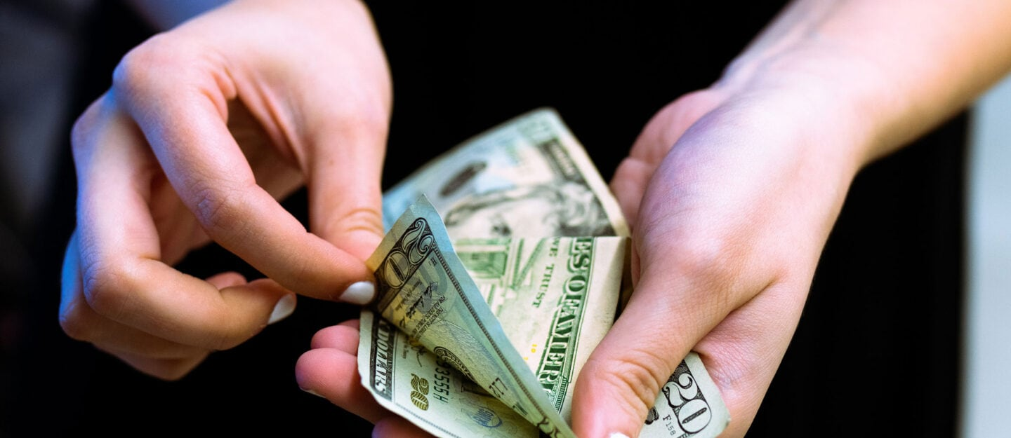 person holds money in hands
