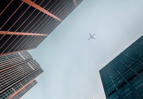 airplane over building