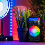 smart home smartphone next to lamp